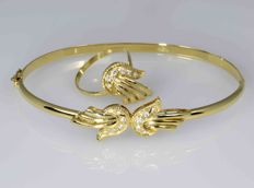 18 kt yellow gold. Set of bracelet and ring - total weight:.  9.02g.
