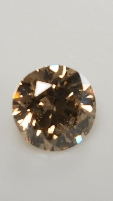 0.72 ct - Round Brilliant - Brown - VS2 - No minimum price