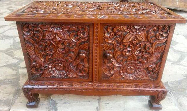Intricately carved wooden jewellery box with 4 drawers plus top compartment on top for rings and a secret compartment covered with prized red velvet.