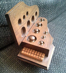 A full wooden weights block, in the shape of a piano, second half of 20th century, the Netherlands