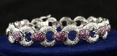 Modern interlinked bracelet with brilliant cut diamonds and rose sapphires