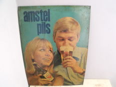Antique tin sign for Amstel Lager.