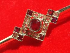 Hand-crafted antique pin – Gold, rubies, and diamonds.