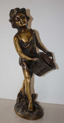 Bronze (heavy) sculpture of a girl carrying a basket