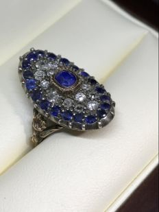Antique gold ring with diamonds and sapphires.