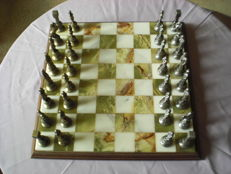 Chess set with classic tin/metal chess pieces and marble chessboard