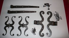 Wrought iron - Sets of moustache-shaped hinges - France - first part of the 19th.