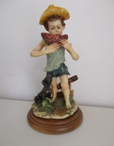 Capodimonte-Melon eating boy with dog.