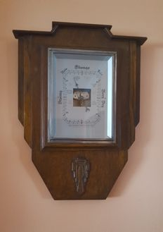 Barometer from the 1940s with a wooden box with typical art deco carved motive.