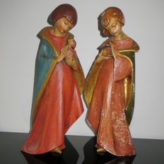 Two large hand carved polychrome wooden figures