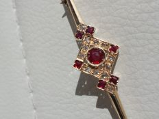 Hand–crafted antique pin – Gold, rubies, and diamonds.