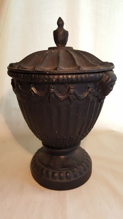 Heavy cast iron (flower) pot or urn (?) with opening in bottom
