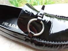 Prada – Loafers.