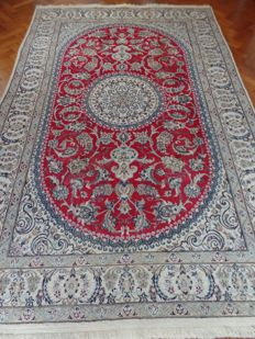 Nain, 197 cm x 305 cm Hand-knotted Persian carpet, with an exclusive colour scheme in red.