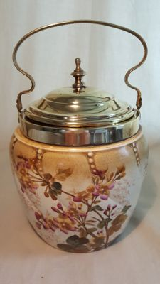 Art Nouveau porcelain hand-painted cookie jar with brass lid and handle; numbered