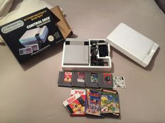 Complete set NES in box and 4 games