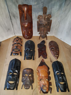 10 African masks including an elephant mask and a Kpelie-mask