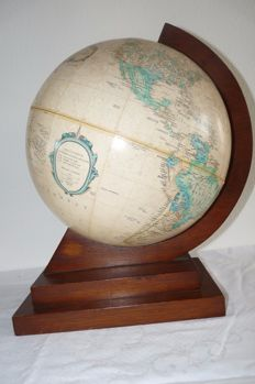 Old relief globe on retro wooden base