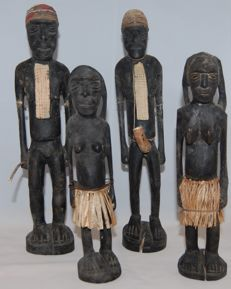 4 carved figures 2 males / 2 females
