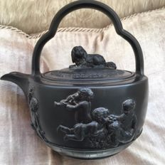 Wedgwood Black Basalt, a teapot in relief with dog and cherubs