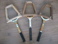 3 wooden tennis rackets with 3 wooden clamps
