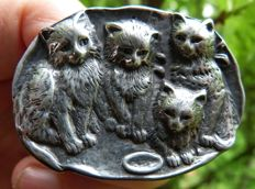 Silver brooch with cats