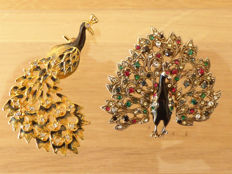 Two old peacock brooches