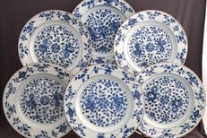 Series of six identical plates with full, floral décor - China - 18th century .