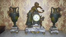 Superb decoration of the mantelpiece with clock, pendulum, regulator, bronze and white marble. Made in France.
