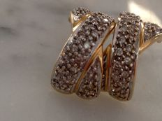 Earrings in 18 kt gold and diamonds.
