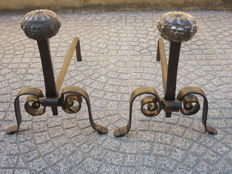 Antique pair of wrought iron andirons with large bronze knob depicting masks, late 19th century, Italy