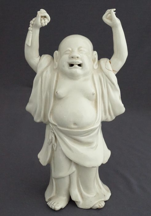 Blanc de Chine sculpture of a standing Happy Buddha - China - 19th century