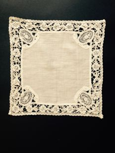 Linen ladies handkerchief of batiste and lined with handmade Brussels needle lace. Dating 19th century