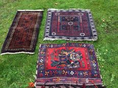Two beautiful hand-knotted carpets with a beautiful camel bag