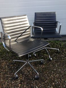 Charles & Ray Eames by ICF - lot of two aluminium group 'EA117' chairs