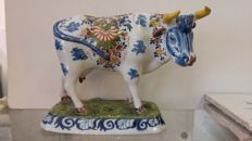 Multicoloured cow made of Delft earthenware