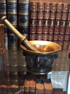 Later cast of a 16th century bronze mortar with original pestle