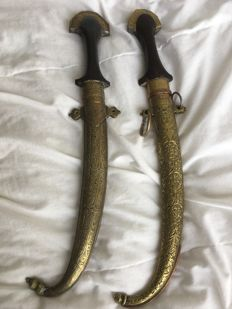 Two brass Koummya daggers - Morocco, Berber - Early 20th century