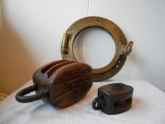 Heavy brass porthole and two wooden pulleys