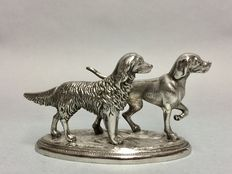 Pair of hunting dogs as silver plated table piece, England, ca 1940