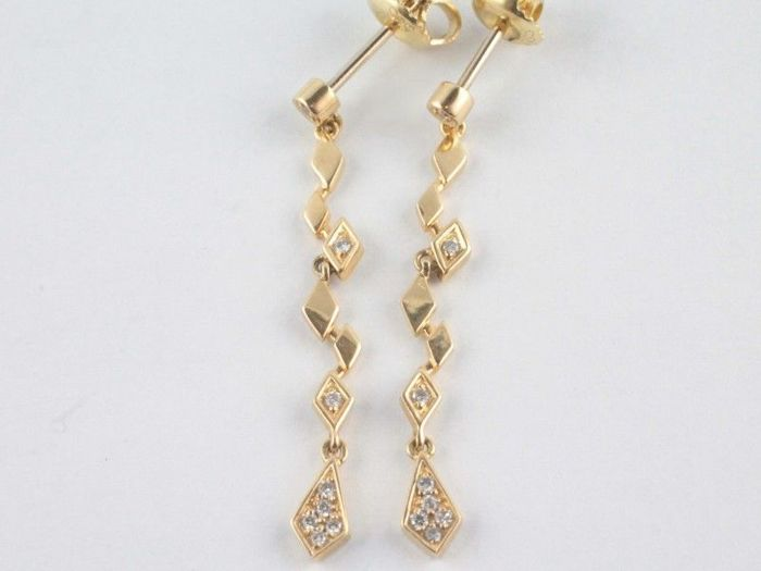 Earrings  14 Kt. Yellow gold with diamonds