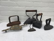 Bronze dish & five cast iron irons