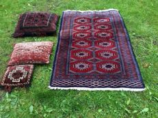 Beautiful hand-knotted Persian carpet with three free hand-knotted cushions