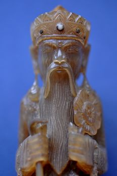 Statue of an old man carved from water buffalo horn - Indonesia