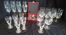 16-Piece Engraved crystal glasses, including Bohemia, with chest with wine accessories