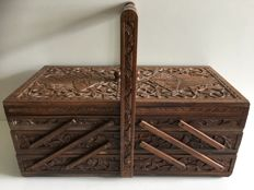 Hand-carved oak, foldable trapeze model sewing box, early 20th century