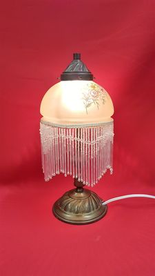 Table lamp with glass beads and bronze frame