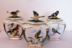 Three PMI porcelain lidded pots decorated with birds