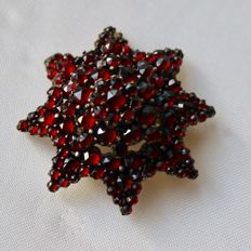 Victorian large gold and silver brooch in the form of a star built upon multiple levels with antique rose cut Garnets