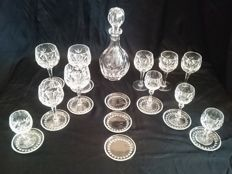 11 Heavy cut crystal carafe and glasses with crystal coasters